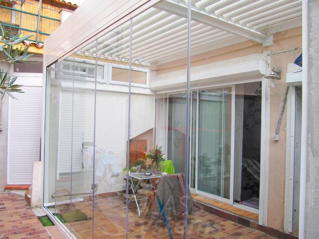 fermeture en verre pergola bioclimatique